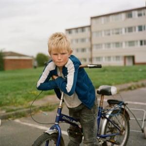 Callum rides his bike on the Lawns.