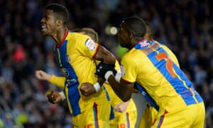 Wilfried Zaha celebrates with team-mate Yannick Bolasie after scoring his first goal during the last match between Crystal Palace and Brighton – in the Championship play-off semi-final second leg at the Amex Stadium in May 2013.
