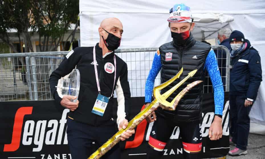 Mauro Gianetti and Tadej Pogacar pose with the Tirreno-Adriatico Trident trophy in March.
