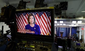 Pelosi is seen on a briefing room monitor at the White House, reading a statement announcing a formal impeachment inquiry.