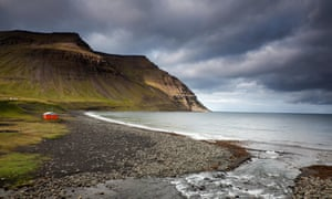 Scenic view of cliffs and ocean, Skalavik, Isafjordur, West Fjords, Iceland.