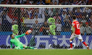 Croatia's Danijel Subasic saves a penalty from Russia's Fyodor Smolov during the shootout.