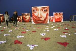 An art installation calling out violence against women staged on Rio de Janeiro's Copacabana beach.