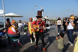 Actors in costumes in Tel Aviv. Israel imposed a curfew for the holiday as a precaution against the spread of coronavirus