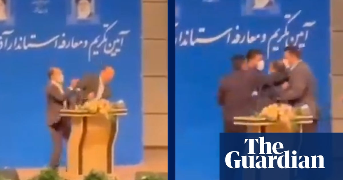 Iranian regional mayor is slapped in the face during inauguration – video