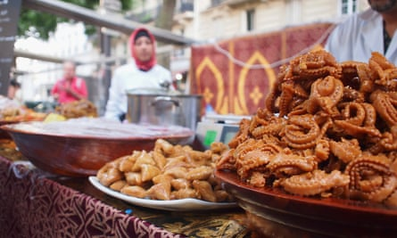 Middle Eastern pastries for sale at a food market in Paris.