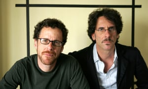 """Ethan Coen, Joel Coen<br>** FILE ** Filmakers Ethan Coen, left and Joel Coen, pose for a portrait while promoting their new movie """"No Country For Old Men,"""" at the Four Seasons Hotel in Los Angeles, in this Nov. 4, 2007, file photo. The Coen brothers earned a nomination Tuesday, Jan. 8, 2008, as best filmmaker from the Directors Guild of America for their bloody crime saga """"No Country for Old Men.""""  (AP Photo/Stefano Paltera, file)"""