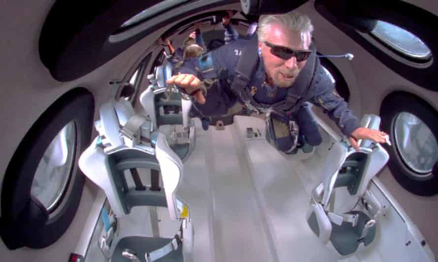 Billionaire Richard Branson floats in zero gravity at the edge of space on Virgin Galactic's rocket.