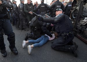Belfast, Northern Ireland Police officers help a girl who was trapped under a moving car after an alleged loyalist drove over her as they reversed at high speed on the return journey towards the controversial Ardoyne flashpoint during the Twelfth of July parade