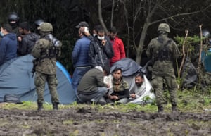 Polish security forces surround migrants stuck along the border with Belarus.