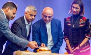 Rajesh Agrawal and Sadiq Khan help temple president, Sruti Dharma Das, to light candles at the opening ceremony of Diwali in Trafalgar Square last October