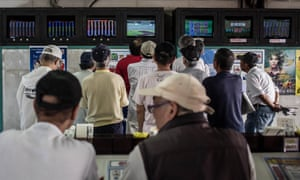 Punters watch a race on the betting screens at the Kawasaki Velodrome in 2015