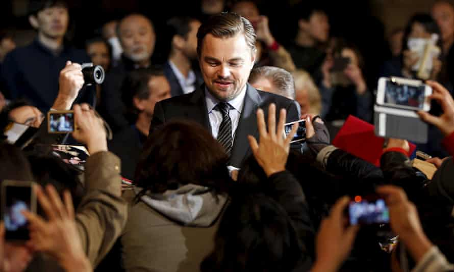 """Oscar-winning actor Leonardo DiCaprio signs autographs for fans during the Japan premiere of his movie """"The Revenant"""" in Tokyo, Japan<br>Oscar-winning actor Leonardo DiCaprio (C) signs autographs for fans during the Japan premiere of his movie """"The Revenant"""" in Tokyo, Japan, March 23, 2016. REUTERS/Toru Hanai TPX IMAGES OF THE DAY"""