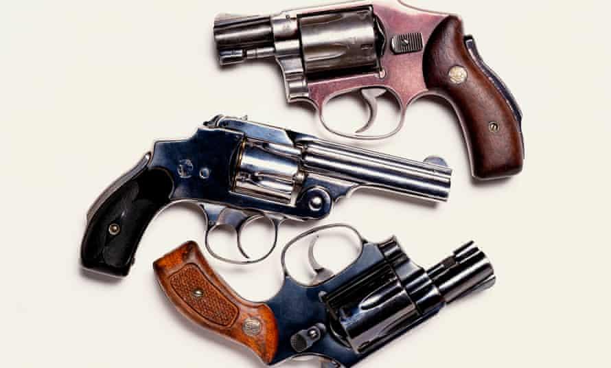 Three handguns, overhead view