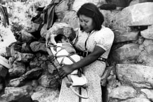 A young Havasupai mother carries her child in a cradle made of basket, in Supai or Havasu Canyon, on 12 August 1941. The remote American Indian reservation is located in one of the tributary gorges of the Grand Canyon.