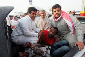 Police detain illegal African immigrants near Thamama, in the Saudi capital Riyadh