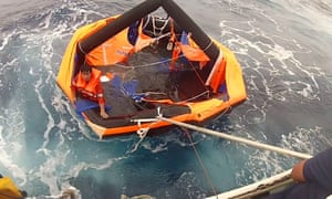 Japan's coast guard rescue a man from a life raft after a cargo ship carrying 43 crew and thousands of cattle sank in a typhoon off the coast.