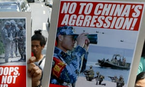 Filipino protesters display placards against China's activities in the South China Sea.