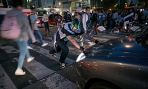Masked campaigner Peatónito pushes back a car that has strayed on to a pedestrian crossing in Mexico City.