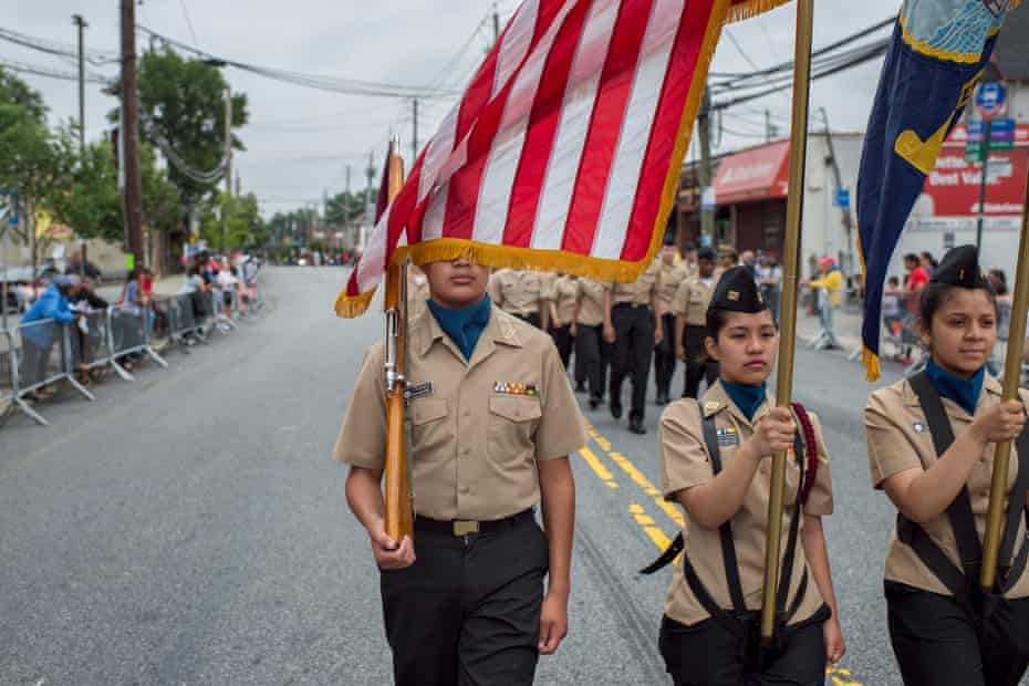 Garet Smit photographs participants at the 100th annual Memorial Day Parade on Staten Island.