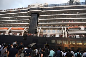 Passengers leave the Westerdam cruise ship in Sihanoukville, Cambodia on Friday.