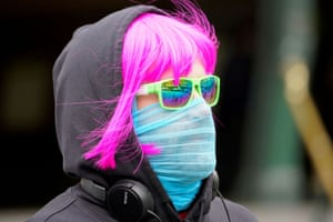 A person wears a scarf as a protective face mask in Melbourne.
