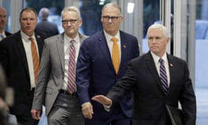 Vice President Mike Pence, right, arrives with Washington for a news conference, Thursday, March 5, 2020 at Camp Murray in Washington state.