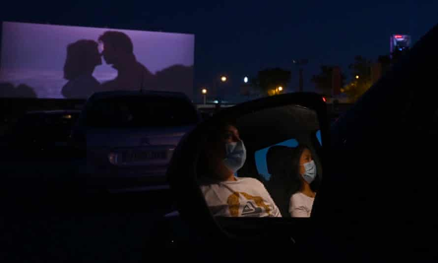 Cinema-goers attend a drive-in screening of Grease in Madrid