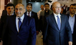 Iraq's new prime minister, Adel Abdul-Mahdi, front left, with, right, the country's president, Barham Salih.