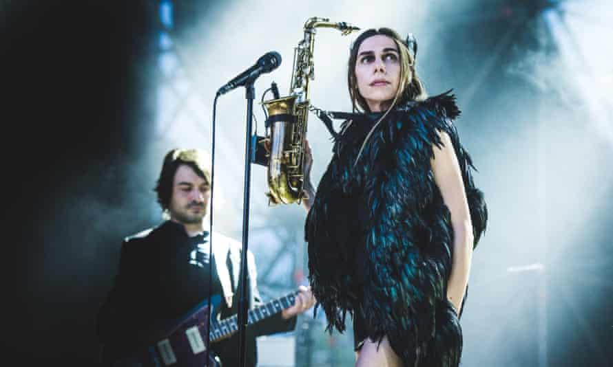 PJ Harvey performing live on stage