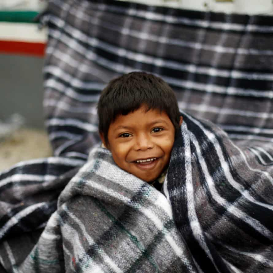 Jose, smiles after waking up near the San Ysidro check-point, 30 April