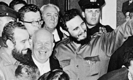 Fidel Castro stands with Soviet leader Nikita Khrushchev, center left, outside Hotel Theresa in Harlem, New York, in 1960.