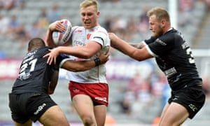 Hull KR's Ben Kavanagh is stopped by the Hull defence