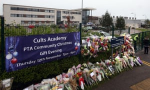 Flowers outside Cults Academy after the stabbing.