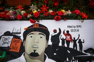 A banner rests over the shrine for Alex Nieto, who was fatally shot by San Francisco police officers in March 2014, at Bernal Heights Hill, in San Francisco.