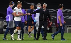 Tottenham Hotspur manager Jose Mourinho and Erik Lamela celebrate their victory.