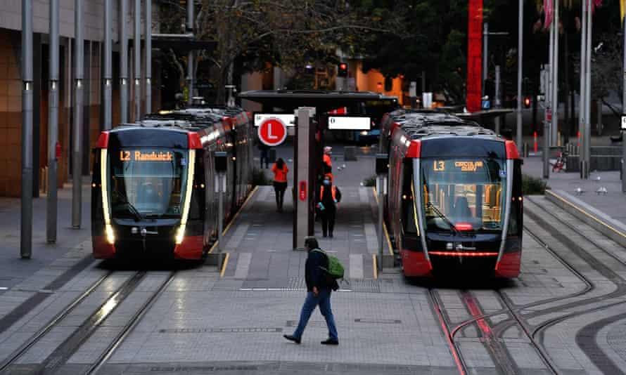 A man walk along the deserted Circular Quay tram terminal