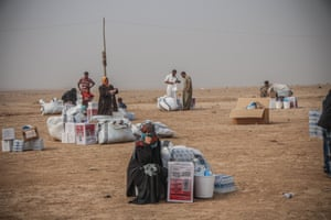 Emergency supplies including water, food and hygiene items is received in Ibrahim al-Khalil, in Iraq's Ninewa governorate