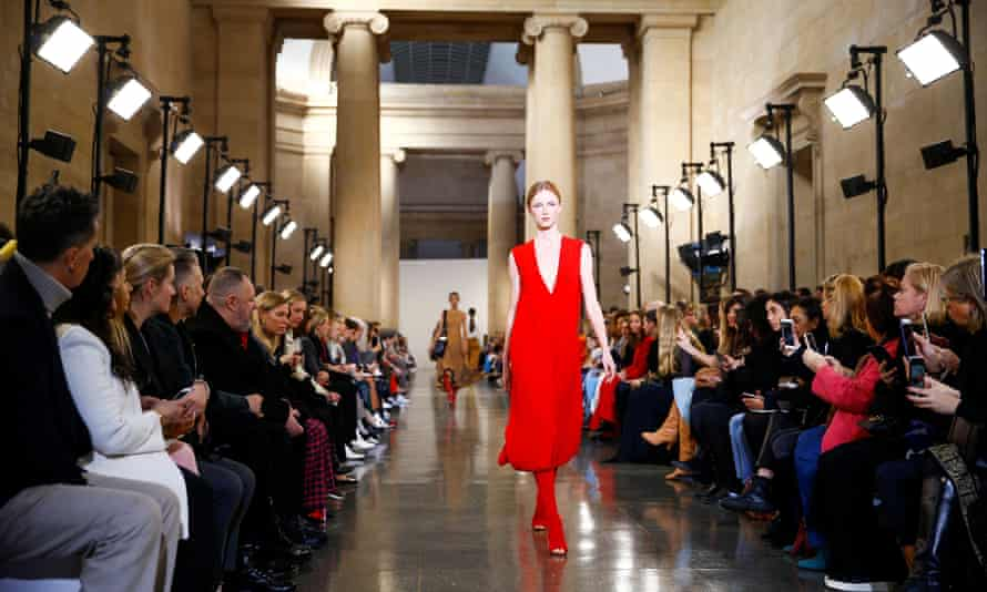 A model makes her way down the catwalk at Victoria Beckham's London fashion week show