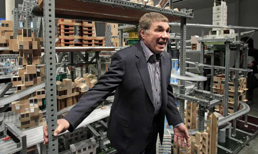 Chris Burden in 2012 in front of his kinetic sculpture, Metropolis II, at the Los Angeles County Museum of Art