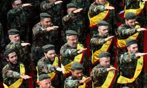 Hezbollah fighters salute