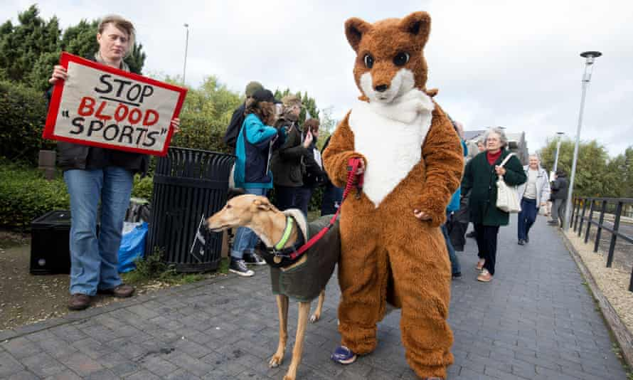 Anti-hunt campaigners outside the National Trust's annual meeting on 22 October.
