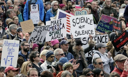 Members of the scientific community, environmental advocates, and supporters demonstrate on Sunday in Boston.