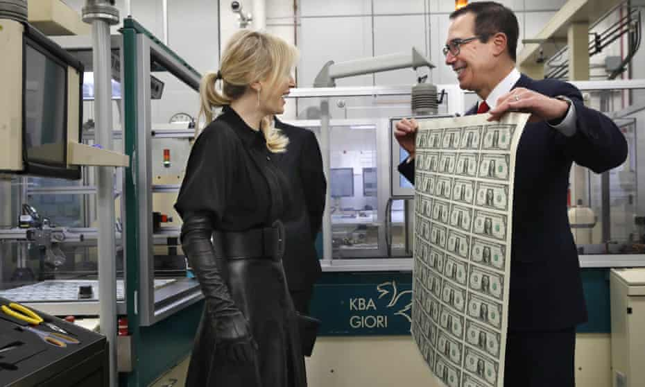 Louise Linton and Steven Mnuchin react as he holds up a sheet of freshly printed dollars.