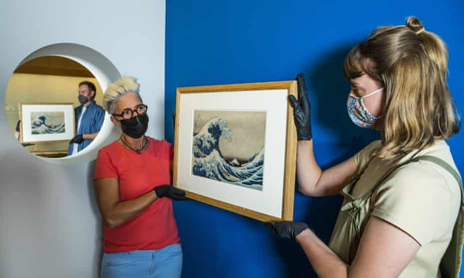 Two versions of Katsushika Hokusai's most celebrated print Under the Wave off Kanagawa (1831), popularly called The Great Wave before they are installed on the wall at the British Museum
