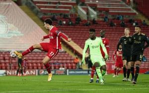 Liverpool's Curtis Jones scores after an error by Onana.