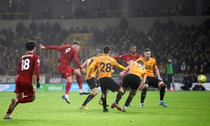 Liverpool's Roberto Firmino (second left) scores his side's winning goal against Wolves at Molineux.