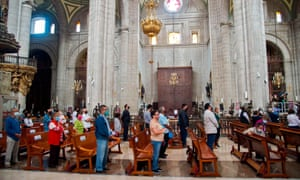 Worshippers keep a safety distance during the first mass in the Metropolitan Cathedral following the resumption of activities, after measures and restrictions to fight the spread of the coronavirus were eased in Mexico City.