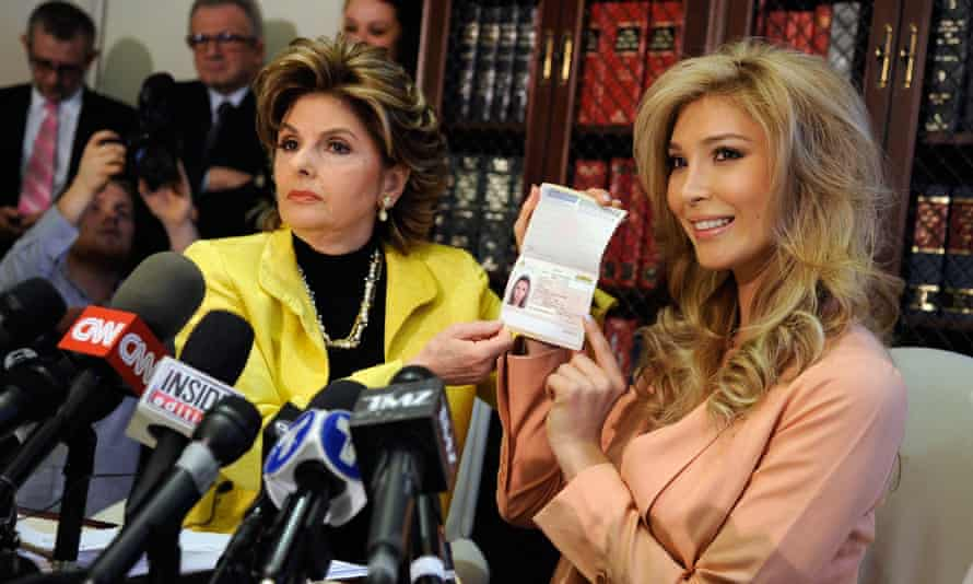 Jenna Talackova shows her Canadian passport, as a proof that she is a female, during a news conference with Gloria Allred