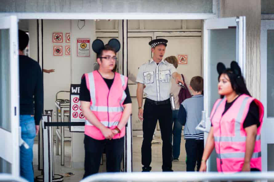 The entrance resembles an airport security zone at the opening of Banksy's Dismaland.
